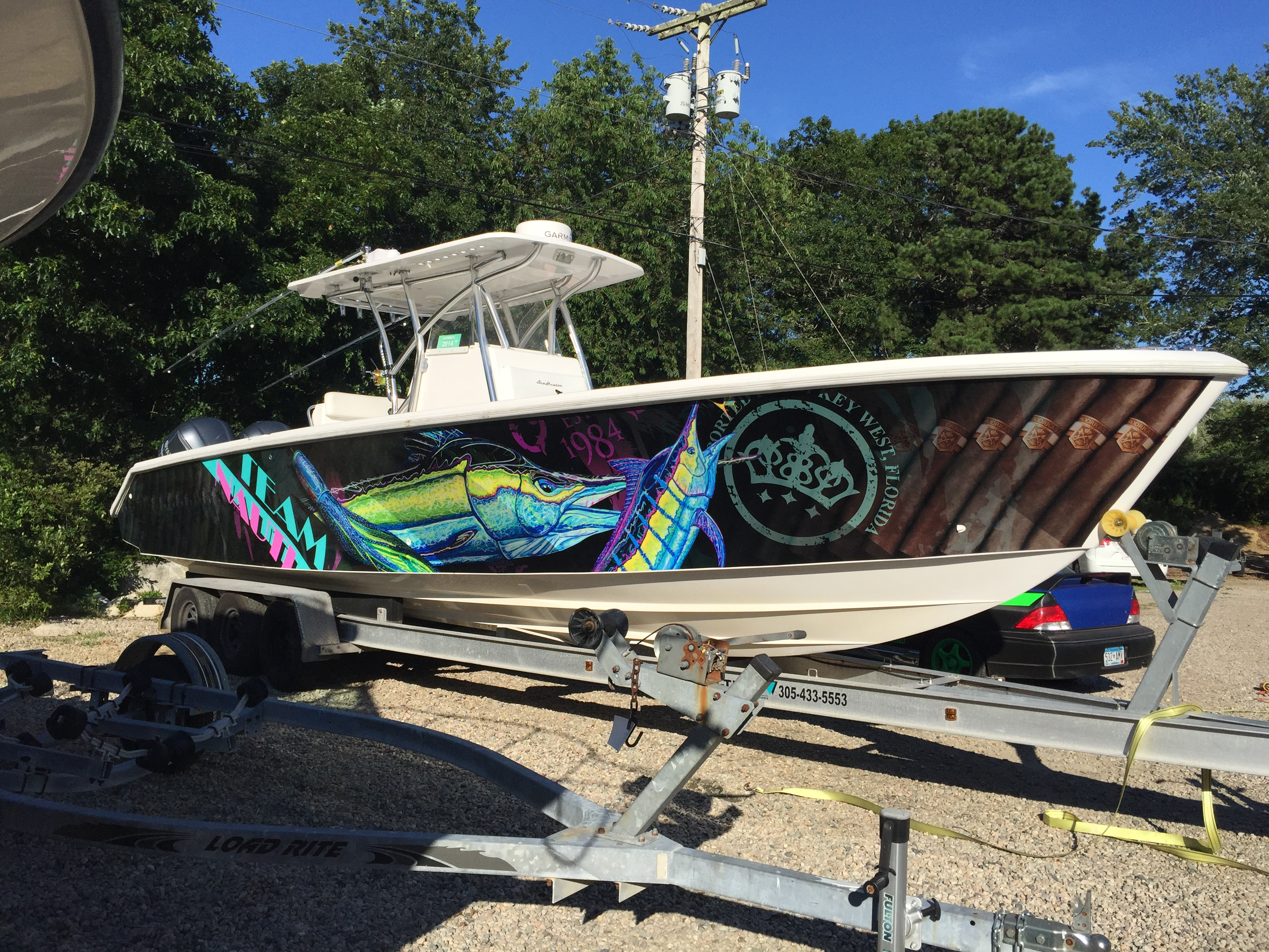 Ultimate boat wraps the boat wrap experts for Fishing boat wraps